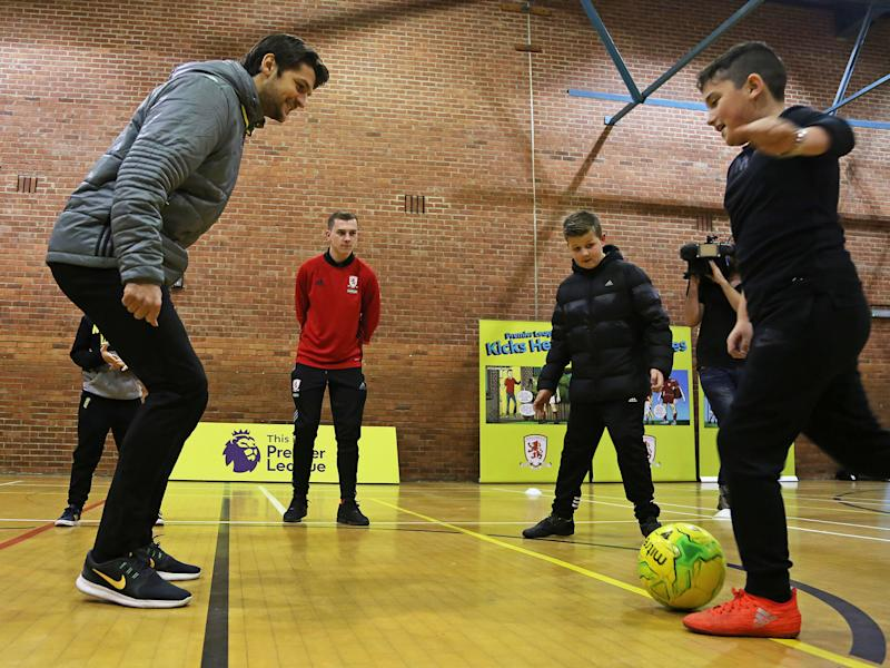 Youngsters from Middlesbrough take part in a session with defender George Friend: Getty