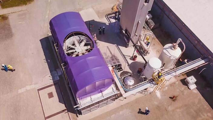 A giant fan is visible in an aerial view of an industrial plant.