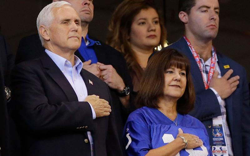 Mike Pence stands during the national anthem - AP