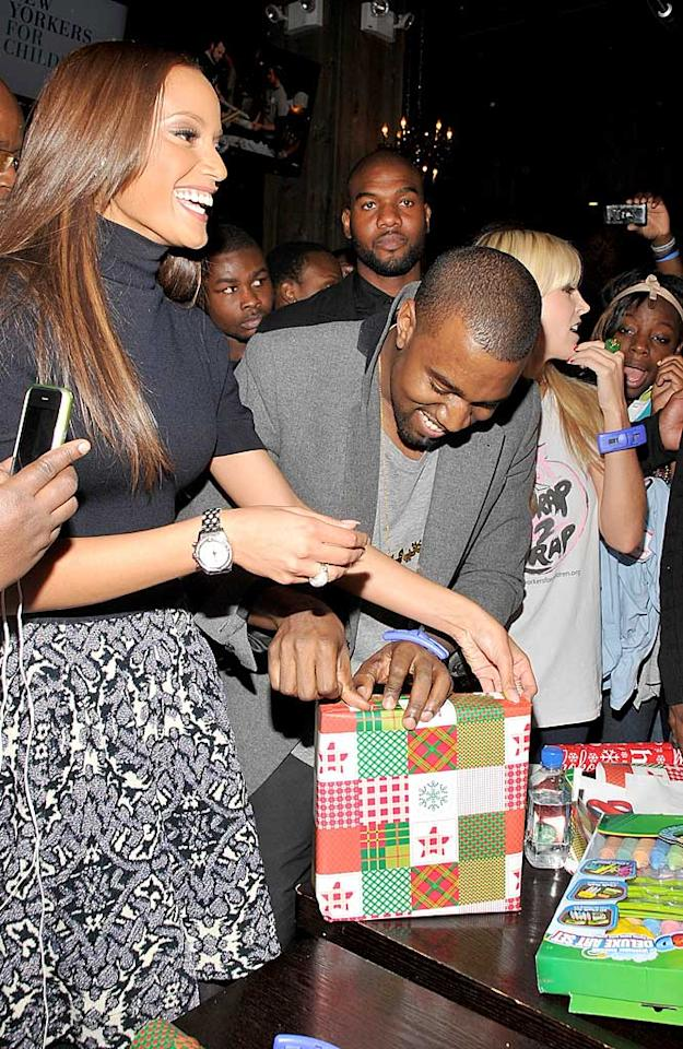"""Some other celebs giving back this festive season? Kanye West and his lady friend, model Selita Ebanks, who dropped in to lend a hand at the New Yorkers for Children Wrap to Rap benefit on Tuesday. The gifts will be distributed to kids in foster care throughout NYC. Joe Corrigan/<a href=""""http://www.gettyimages.com/"""" target=""""new"""">GettyImages.com</a> - November 30, 201"""