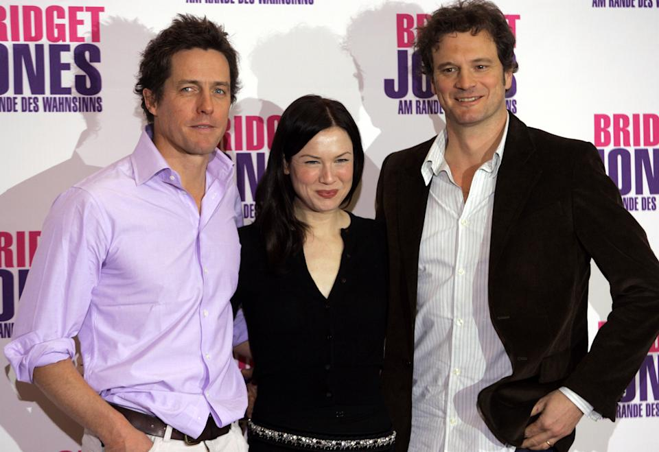 Zellweger, Grant and Firth pose for the media to promote the movie ' Bridget Jones - Beyond the Edge of Reason ' in Berlin.  U.S. actress Renee Zellweger (C) and British actor Hugh Grant and Colin Firth (R) pose for the edia to promote the movie ' Bridget Jones: Beyond the Edge of Reason ' in Berlin November 12, 2004. REUTERS/Michael Dalder