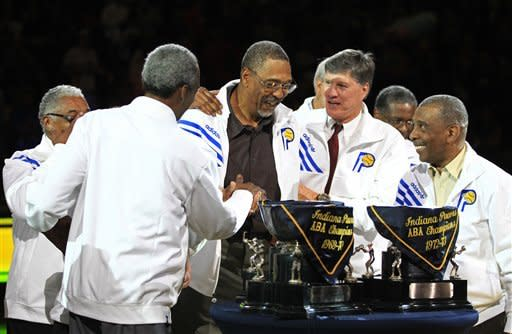 Indiana Pacers' Mel Daniels, center, is congratulated by his ABA teammates in a ceremony honoring Daniels and the ABA championship teams during halftime of an NBA basketball game between the Pacers and Chicago Bulls, Wednesday, April 25, 2012, in Indianapolis. (AP Photo/Darron Cummings)