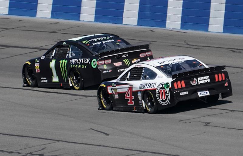 Kurt Busch (1) and Kevin Harvick (4) head into Turn 2 during the NASCAR Cup Series auto race at Auto Club Speedway in Fontana, Calif., Sunday, March 17, 2019. (AP Photo/Rachel Luna)