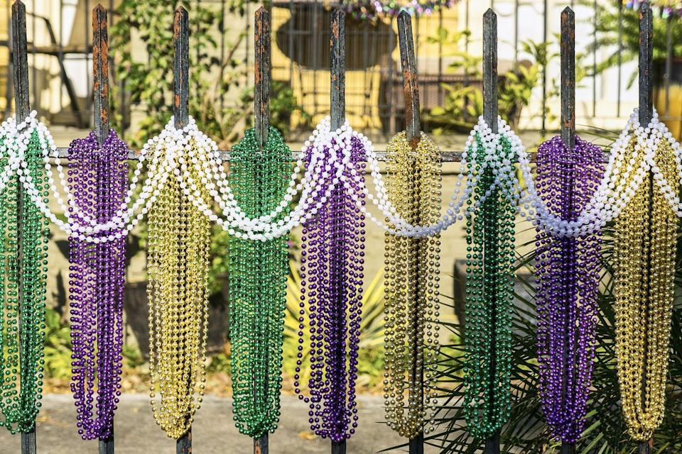 "<p>One of the most recognizable aspects of Mardi Gras is throwing beads. Mardi Gras ""throws"" is what it's called when parade floats toss beads and trinkets into the crowd. Each krewe throws out something different—including stuffed animals, doubloons, and even coconuts—but beads are usually thrown by all.</p>"