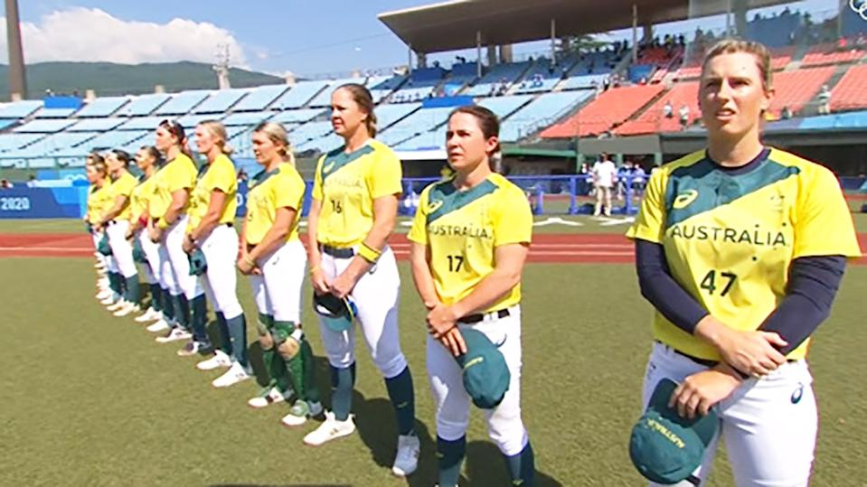 Australia's softballers, pictured here kicking off the Olympics in an empty stadium.