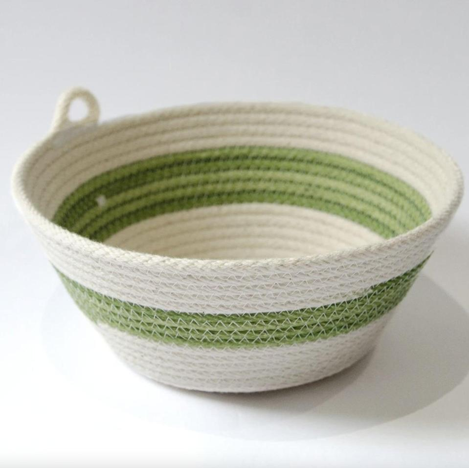 <p>We love the woven style and color of this <span>54Kibo Coiled Cotton Bowl</span> ($40)</p>