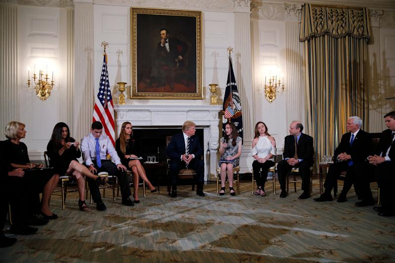 President Donald Trump hosts a listening session with high school students, parents and teachers to discuss school safety at the White House on Wednesday.