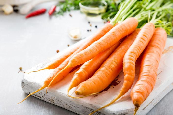 "<p>Their bright orange color is a clue that carrots are loaded with antioxidants, namely beta-carotene—which might have something to do with their cancer-fighting abilities. <a href=""https://journals.lww.com/md-journal/fulltext/2018/09140/Association_between_dietary_carrot_intake_and.20.aspx"" rel=""nofollow noopener"" target=""_blank"" data-ylk=""slk:One analysis"" class=""link rapid-noclick-resp"">One analysis</a> concluded that high carrot intake was tied to a 21% lower chance for breast cancer, while <a href=""https://link.springer.com/article/10.1007%2Fs00394-014-0667-2"" rel=""nofollow noopener"" target=""_blank"" data-ylk=""slk:another"" class=""link rapid-noclick-resp"">another</a> concluded that carrot consumption could help stave off <a href=""https://www.prevention.com/health/a20483916/prostate-cancer-risk-factors/"" rel=""nofollow noopener"" target=""_blank"" data-ylk=""slk:prostate cancer"" class=""link rapid-noclick-resp"">prostate cancer</a>. </p><p><strong>Try it:</strong> <a href=""https://www.prevention.com/food-nutrition/recipes/a24743348/roasted-carrots-and-parsnips-recipe/"" rel=""nofollow noopener"" target=""_blank"" data-ylk=""slk:Spice-Roasted Carrots and Parsnips with Yogurt and Turmeric Vinaigrette"" class=""link rapid-noclick-resp"">Spice-Roasted Carrots and Parsnips with Yogurt and Turmeric Vinaigrette</a></p>"