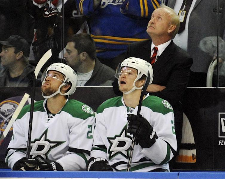 Dallas Stars' head coach Lindy Ruff looks at the scoreboard for a video tribute about his career in Buffalo during the first period of an NHL hockey game against the Buffalo Sabres in Buffalo, N.Y., Monday, Oct. 28, 2013. (AP Photo/Gary Wiepert)