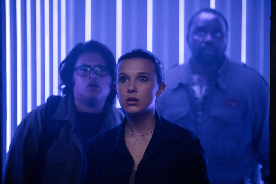 "This image released by Warner Bros. Entertainment shows Millie Bobby Brown, center, Julian Dennison, left, and Brian Tyree Henry in a scene from ""Godzilla vs. Kong."" (Warner Bros. Entertainment via AP)"