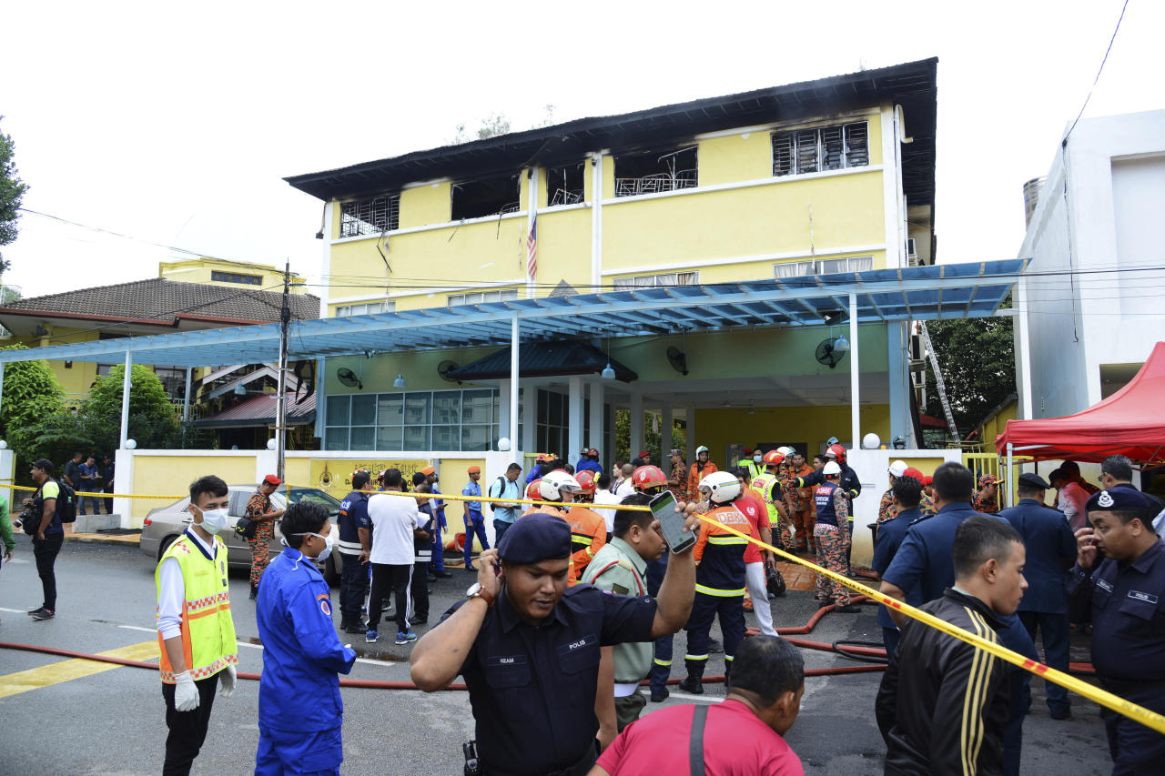 <p>Police and rescue personnel work at an Islamic religious school cordoned off after a fire on the outskirts of Kuala Lumpur Thursday, Sept. 14, 2017. A fire department official in Malaysia said a fire at the Islamic religious school has killed people, mostly teenagers. (Photo: AP) </p>