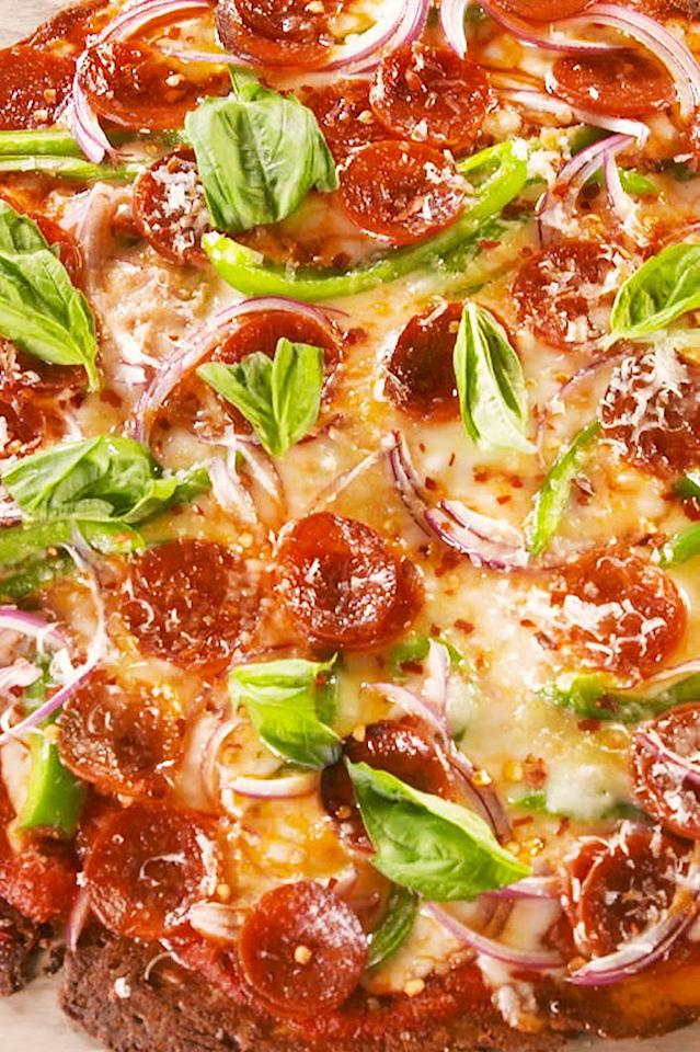 "<p>Craving homemade pizza but can't do the carbs? This keto pepperoni pizza is here to save the day! Feel free to top with your favourite keto-friendly veggies if peppers and onions aren't your thing. </p><p>Get the <a href=""https://www.delish.com/uk/cooking/recipes/a30323634/keto-pepperoni-pizza-recipe/"" target=""_blank"">Keto Pepperoni Pizza</a> recipe.</p>"