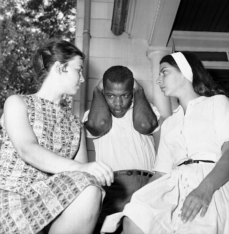John Lewis, center, national chairman of the Student Nonviolent Coordinating Committee explains protective measures to two white students participating in the civil rights movement in Cambridge, Md., July 18, 1963. Lewis, from the Atlanta, Ga., office of the student group, was there to help in the integrationist struggle. On left is Gretchen Schwarz of Philadelphia, while Carol Rogoff of Brooklyn, N.Y., also participates. (Photo: William A. Smith/AP)