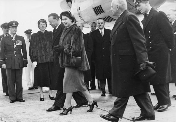 <p>Then Princess Elizabeth II and Prince Philip (right, wearing a hat) are accompanied by Harold Alexander, Governor General of Canada, as they arrive at Dorval Airport in Montreal. [Getty/ Paul Popper]<br /></p>