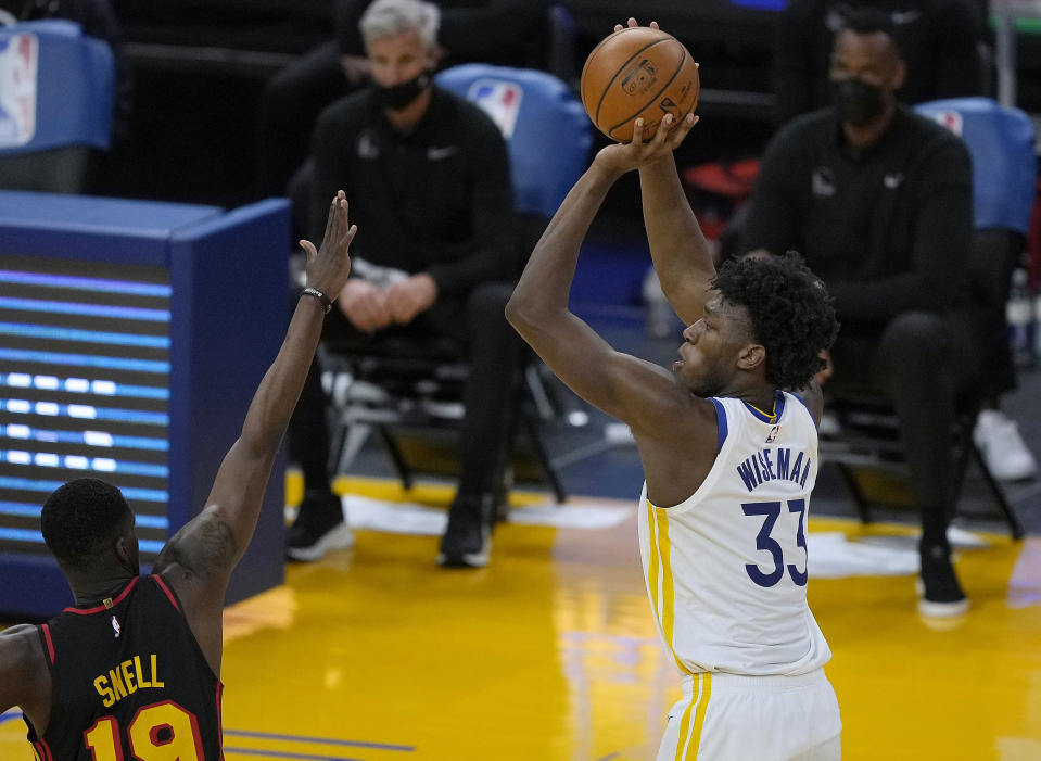 Golden State Warriors center James Wiseman (33) shoots over Atlanta Hawks forward Tony Snell (19) during the first half of an NBA basketball game in San Francisco, Friday, March 26, 2021. (AP Photo/Tony Avelar)
