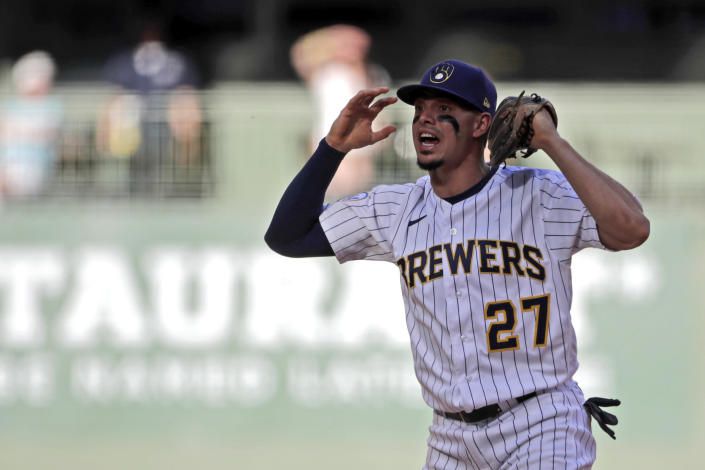 Milwaukee Brewers' Willy Adames yells to the dugout to ask for a review on a play at second base during the eighth inning of a baseball game against the Arizona Diamondbacks, Saturday, June 5, 2021, in Milwaukee. (AP Photo/Aaron Gash)