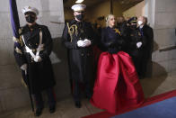 Lady Gaga, flanked by Marine escort Capt. Evan Campbell, arrives to sing the National Anthem for the 59th Presidential Inauguration at the U.S. Capitol for President-elect Joe Biden in Washington, Wednesday, Jan. 20, 2021. (Photo by Win McNamee/Getty Images/Pool Photo via AP)