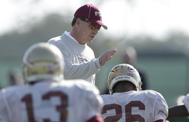 Florida State head coach Jimbo Fisher greets defensive back P.J. Williams, right, during an NCAA college football practice on Friday, Jan. 3, 2014, in Costa Mesa, Calif. Top-ranked Florida State is to face No. 2 Auburn in the BCS championship game on Jan. 6 in Pasadena, Calif. (AP Photo/Gregory Bull)