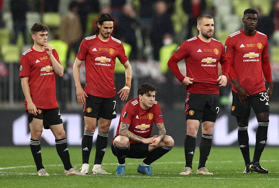 Manchester United players look dejected after losing the Europa League final on penalties to Villarreal.