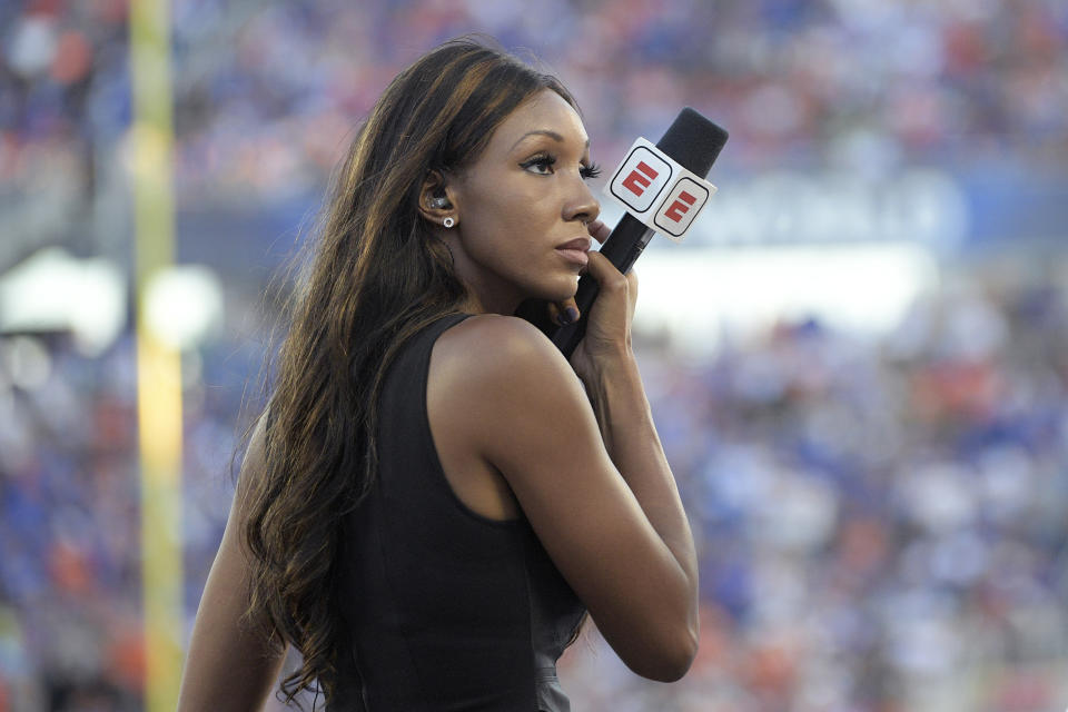 ESPN's Maria Taylor works from the sideline during the first half of an NCAA college football game between Miami and Florida Saturday, Aug. 24, 2019, in Orlando, Fla. (AP Photo/Phelan M. Ebenhack)