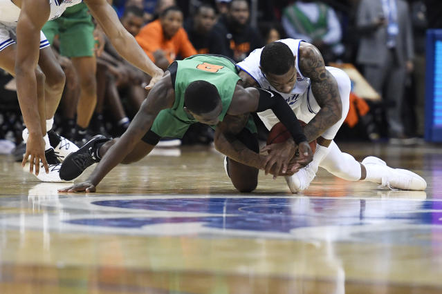 Florida A&M guard Kamron Reaves (2) battles Seton Hall guard Shavar Reynolds (33) for a loose ball during the second half of an NCAA college basketball game, Saturday, Nov. 23, 2019 in Newark, N.J. (AP Photo/Sarah Stier)