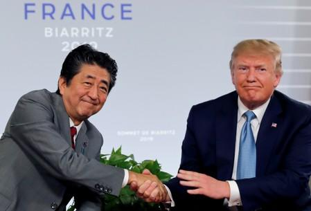 U.S. President Trump and Japan's Prime Minister Abe shake hands at a bilateral meeting during the G7 summit in France