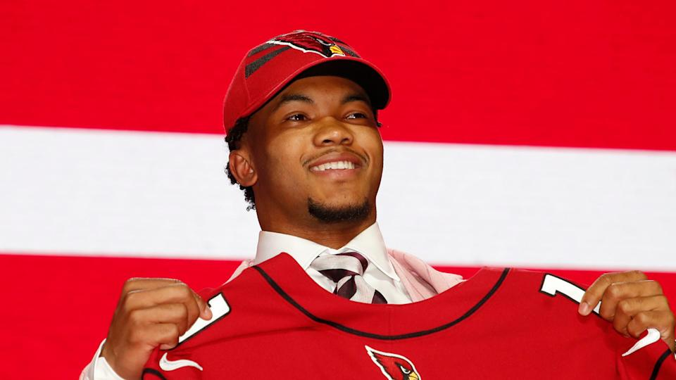 Mandatory Credit: Photo by Jeff Haynes/AP/Shutterstock (10218831fp)Oklahoma quarterback Kyler Murray poses with his new team jersey after the Arizona Cardinals selected Murray in the first round at the NFL football draft, in Nashville, TennNFL Draft Football, Nashville, USA - 25 Apr 2019.