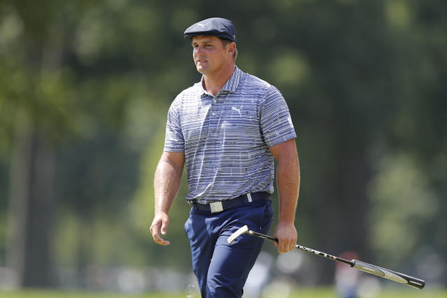 Bryson DeChambeau walks on the 11th green during the third round of the Rocket Mortgage Classic golf tournament, Saturday, July 4, 2020, at the Detroit Golf Club in Detroit. (AP Photo/Carlos Osorio)