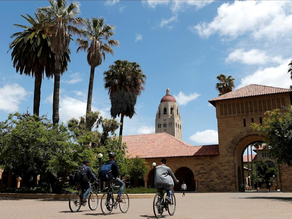 """Cyclists traverse the main quad on Stanford University's campus in Stanford, California, U.S. on May 9, 2014. <p class=""""copyright"""">Beck Diefenbach/Reuters</p>"""