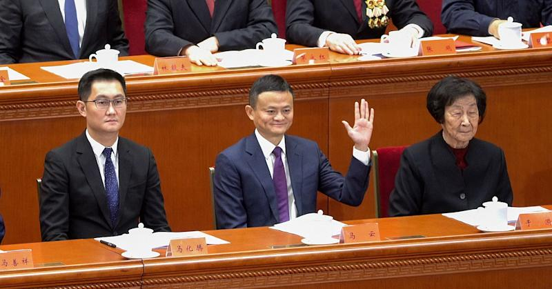 Tencent Holdings' CEO Pony Ma and Alibaba's founder Jack Ma attend a grand gathering to celebrate the 40th anniversary of China's reform and opening-up at the Great Hall of the People on December 18, 2018 in Beijing, China.