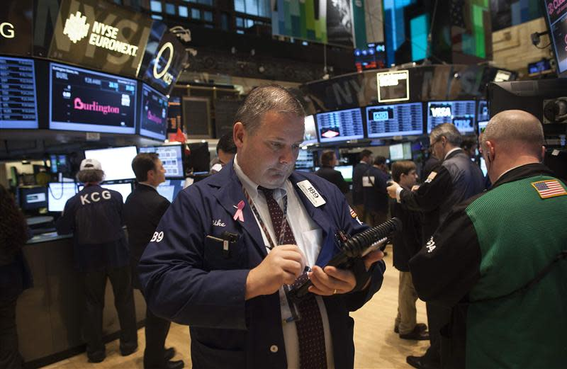 A trader works on the floor of the New York Stock Exchange during the opening bell in New York