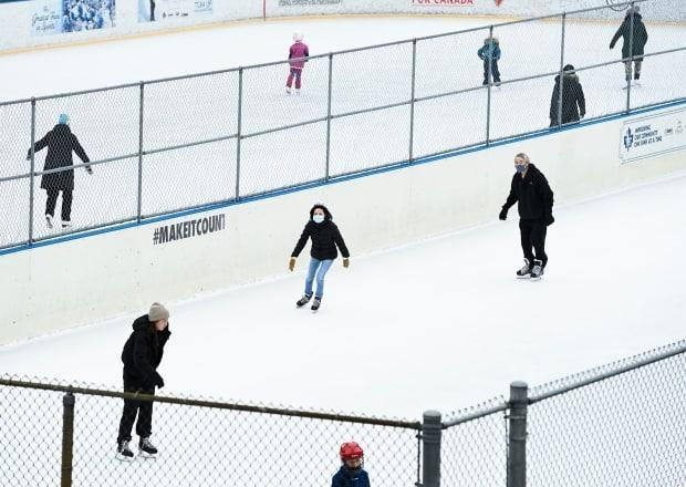 People exercise at an outdoor skating rink during the COVID-19 pandemic in Toronto.