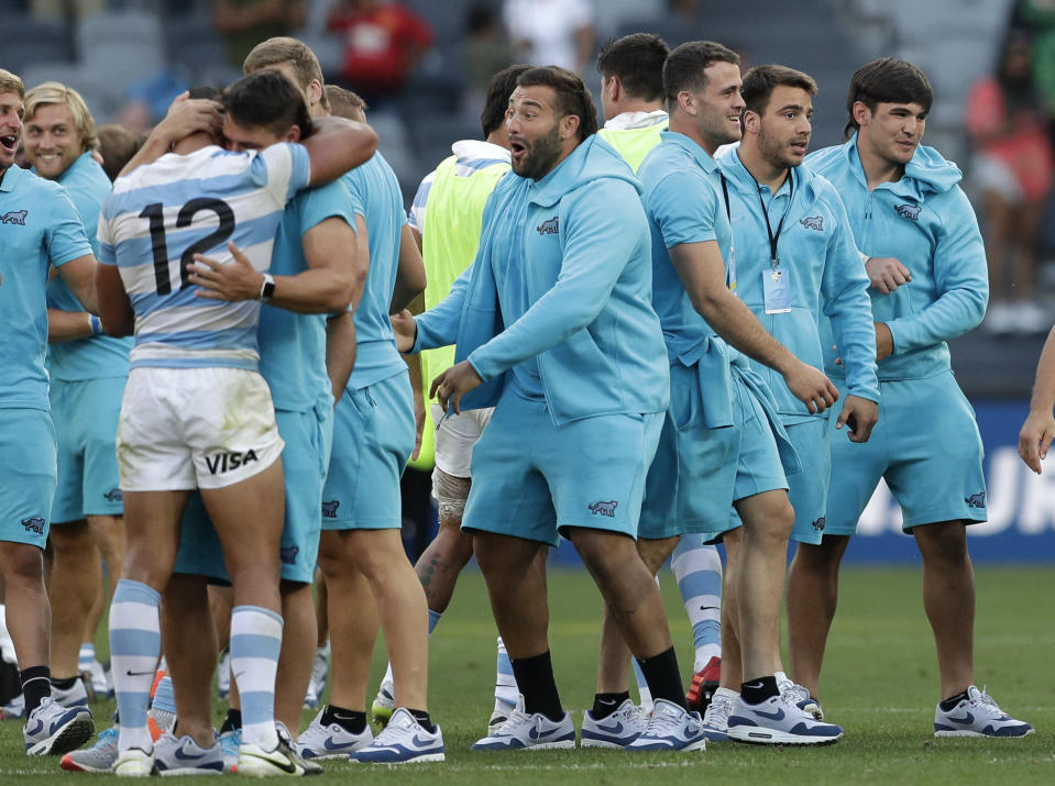 Argentina players celebrate after the Tri-Nations rugby test between Argentina and New Zealand at Bankwest Stadium, Sydney, Australia, Saturday, Nov.14, 2020. Argentina defeated the All Blacks 25-15. (AP Photo/Rick Rycroft)