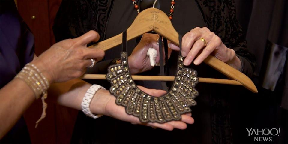 """<p>To express her disapproval over a court ruling, Ginsburg opted for a black bib necklace with rhinestones by Banana Republic. The dark colors and punk-inspired design certainly stood out from her collection of predominantly white lace jabots. """"It looks fitting for descent,"""" she told Couric. </p>"""