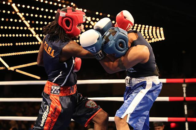 <p>New York's Finest Yaate Turner, left, and Greg Thuesday battle in the ring during the NYPD Boxing Championships at the Theater at Madison Square Garden on June 8, 2017. (Photo: Gordon Donovan/Yahoo News) </p>