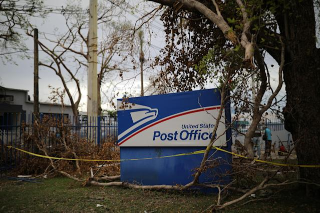 <p>A U.S. Postal Service office sign is seen at a damaged area of San Juan after Hurricane Maria, in Puerto Rico, Oct. 5, 2017. (Photo: Carlos Barria/Reuters) </p>