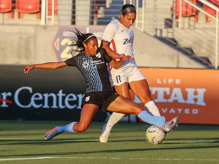 Sky Blue FC's Midge Purce slides for a tackle on OL Reign forward Darian Jenkins.