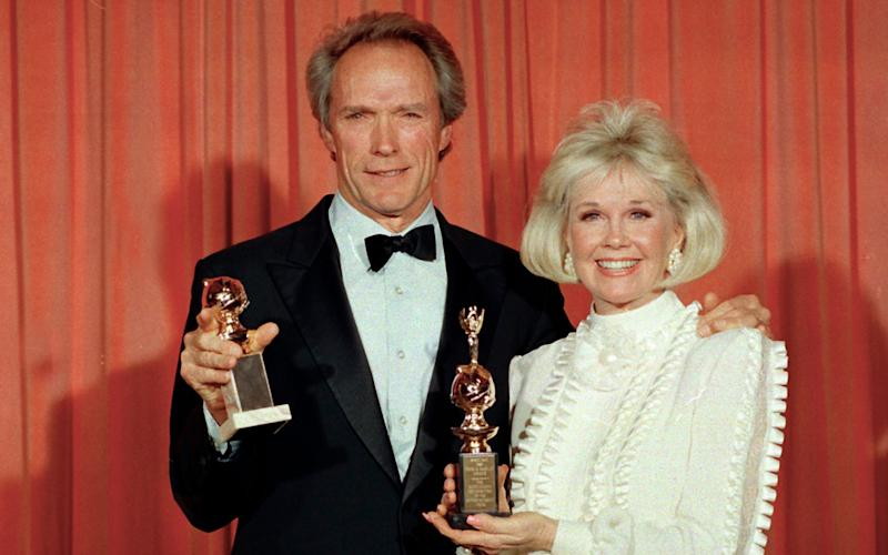 Doris Day pictured with Clint Eastwood in 1989 - Credit: Douglas C. Pizac/AP