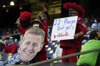 FILE - Houston Texans fans show their support for J.J. Watt (99) during the first half of an NFL football game against the Tennessee Titans in Houston, in this Sunday, Jan. 3, 2021, file photo. It's a sad time for Houston sports fans after multiple superstars have left he city in the last year. (AP Photo/Sam Craft, File)
