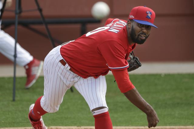 Philadelphia Phillies' Reggie McClain delivers a pitch during a spring training baseball workout Friday, Feb. 14, 2020, in Clearwater, Fla. (AP Photo/Frank Franklin II)