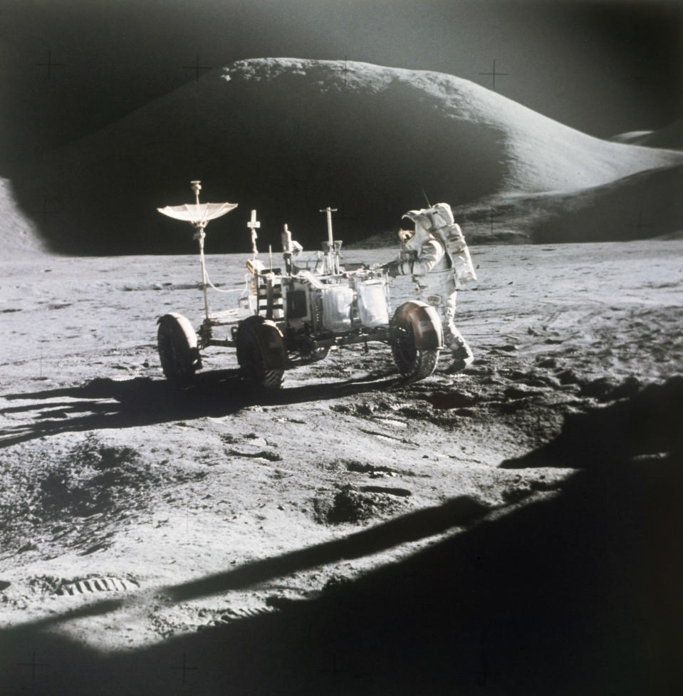 FILE - In this 1971 photo made available by NASA, astronaut James Irwin stands next to a rover on the surface of the moon. On Wednesday, May 26, 2021, Lockheed Martin and General Motors announced that they would combine their technological and manufacturing expertise to build the electric vehicles for NASA's Artemis program, named after the twin sister of Apollo in Greek mythology. (NASA via AP, File)