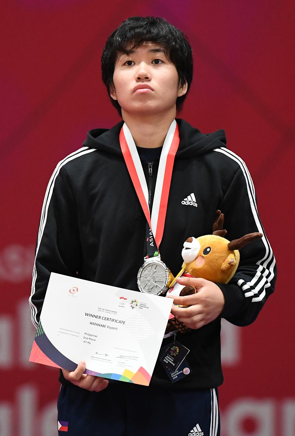 Silver medallist Philippiness Kiyomi Watanabe stands during the awards ceremony women's judo -63 kg at the 2018 Asian Games in Jakarta on August 30, 2018. (Photo by SONNY TUMBELAKA / AFP)        (Photo credit should read SONNY TUMBELAKA/AFP via Getty Images)
