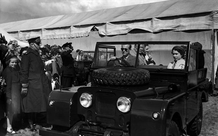 19th May 1955: The Duke of Edinburgh at the wheel of a Land Rover sets off for a tour of the course of the European Horse Trials at Windsor with The Queen  - Terry Disney/Central Press/Getty Images