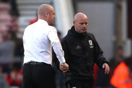 Middlesbrough caretaker manager Steve Agnew shakes hands with Burnley manager Sean Dyche at the end of the match