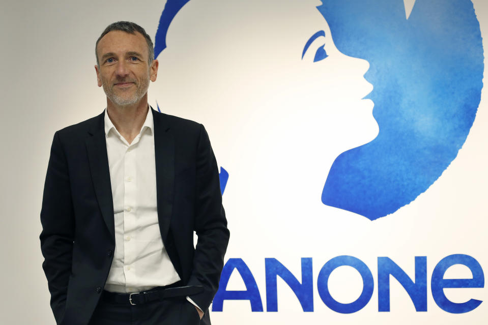 Chief Executive of Danone company Emmanuel Faber poses for photographers prior to the company's 2017 annual results presentation in Paris, Friday, Feb. 16, 2018. Danone, the world's largest yoghurt maker, reported overall 2017 earnings that slightly beat expectations. (AP Photo/Thibault Camus)