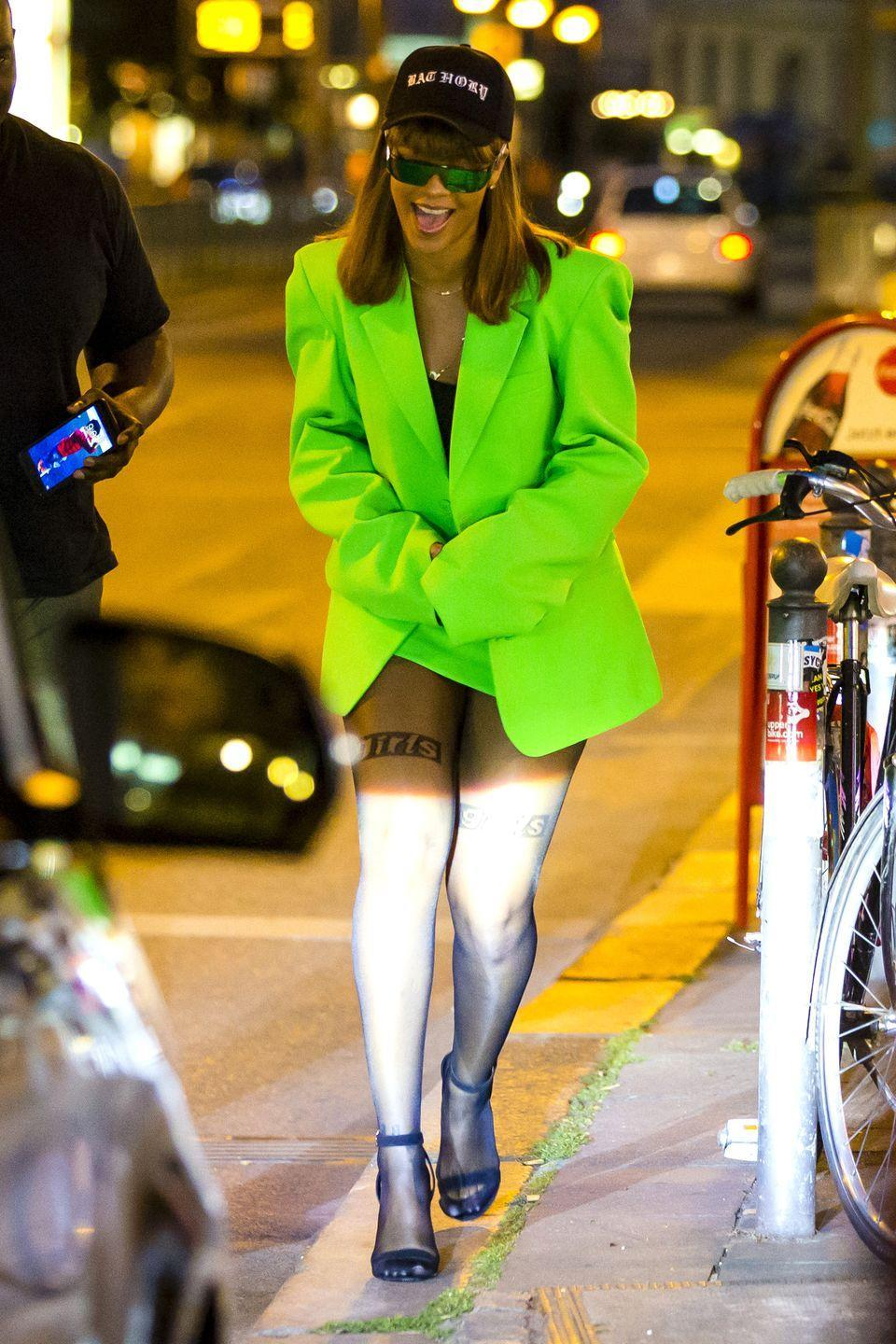 "<p>In a lime green Vetements blazer and skirt co-ord, black top, Alexander Wang tights, black heeled sandals, reflective Dior sunglasses and a dad hat while out in Berlin. She's probably smiling because <a href=""https://www.harpersbazaar.com/celebrity/latest/news/a17231/rihanna-headless-statue-berlin/"" rel=""nofollow noopener"" target=""_blank"" data-ylk=""slk:she just posed with a massive headless statue"" class=""link rapid-noclick-resp"">she just posed with a massive headless statue</a> she inspired.</p>"