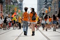 <p>EDITORS NOTE LANGUAGE ON SHIRT Demonstrators participate in the Every Child Matters Walk on Canada Day, in downtown Toronto, on Thursday, July 1, 2021. THE CANADIAN PRESS/Christopher Katsarov</p>