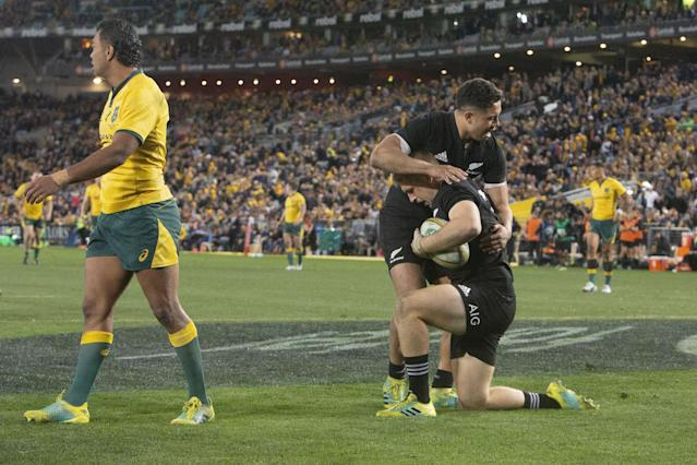 Jack Goodhue celebrates with Anton Lienert-Brown after scoring his try in Sydney