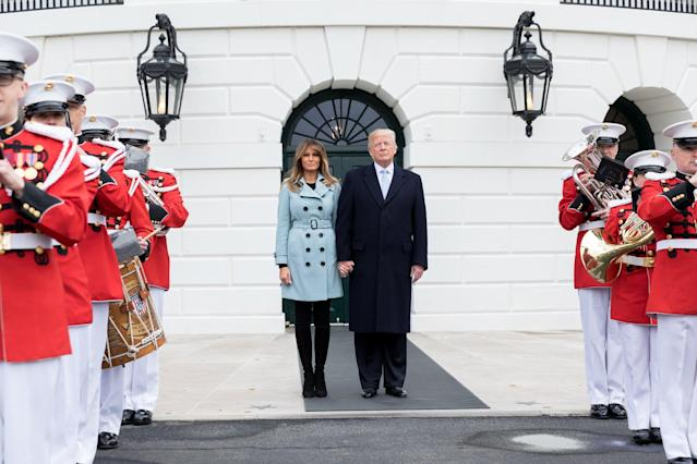 "<p>For the 140th annual Easter Egg Roll at the White House, Melania kept warm in a powder blue Burberry <a href=""https://www.harrods.com/en-gb/burberry/sandringham-mid-length-cashmere-trench-coat-p000000000005620313?dco=UK&pcu=GBP&cid=Shopping_UK_GGL_Burberry_P000000000005620313_Blue_08&_cclid=v3_ade7d5a9-3e51-5160-a402-7cedaf7976a1&gclid=Cj0KCQjw_ZrXBRDXARIsAA8KauQ_rmes5U21FFNHSsHeKr3X3cpXX7hAFTneqcYFldsQh0PuuZhRu2EaAocEEALw_wcB&colour=Blue"" rel=""nofollow noopener"" target=""_blank"" data-ylk=""slk:coat"" class=""link rapid-noclick-resp"">coat</a> which weighs in at £1,795. <em>[Photo: Getty]</em> </p>"