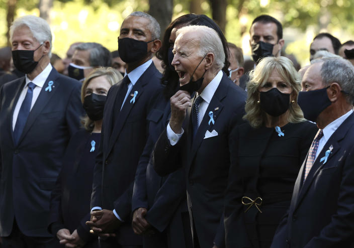 President Joe Biden, center, calls out as he is joined by, from left, former President Bill Clinton, former First Lady Hillary Clinton, former President Barack Obama, former First Lady Michelle Obama, First Lady Jill Biden and former New York City Mayor Michael Bloomberg, during the annual 9/11 Commemoration Ceremony at the National 9/11 Memorial and Museum on Saturday, Sept. 11, 2021 in New York. (Chip Somodevilla/Pool Photo via AP)